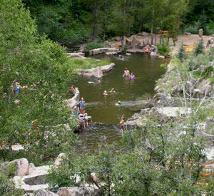 People enjoy the hot springs at Strawberry Springs in Grand County Colorado.