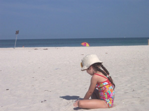 The author's daughter finds plenty of space to play in the sand in Florida's Gulf Coast.