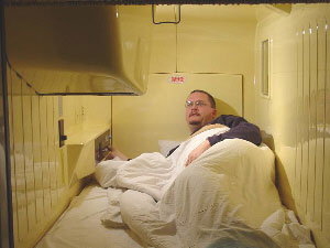 The author at a capsule hotel - cheapest way to stay in Tokyo