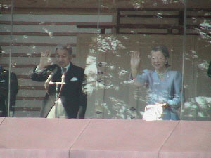 The emperor and the empress wave to the crowds.