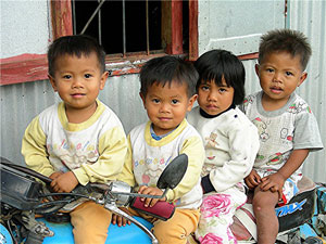 Children on a motorcycle in Bontoc