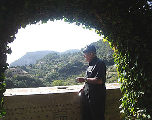 The author is shown at the Cartoixa Reial Monastery in the garden of the Chopin cells.