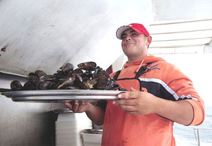 Serving mussels at O Grove