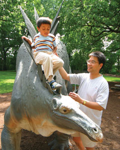 Father and son play at the Cleveland Museum of Natural History.