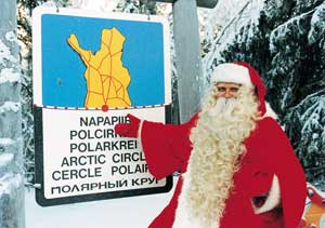 Santa points out the Arctic Circle