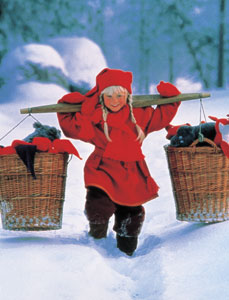 A Finnish girl with baskets of mittens