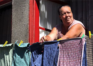 A  woman hangs her wash out to dry in Porto, Portugal. Photos by Paul Shoul