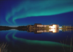 A highlight of the autumn and winter seasons, the northern lights shimmer in breathtaking swirls over the Prince of Wales Northern Heritage Center. Photo by Stephen Cumming