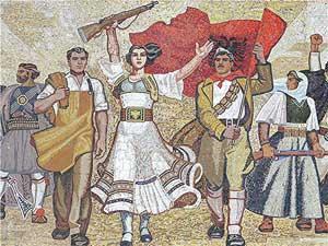 A mural in Tirana, Albania, commemorates the revolutionary struggle. Photos by David Rich