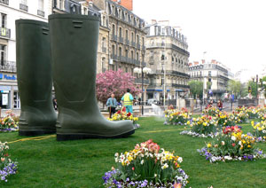 Downtown Dijon gets ready for spring with oversized Wellies and new flowers.