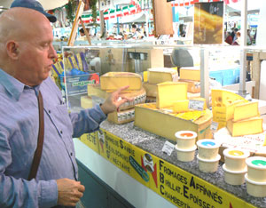 Alex Miles at his favorite cheese stall in Dijon's Market.