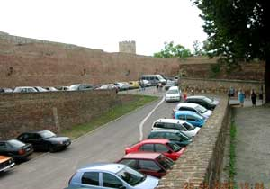 Cars are parked everywhere in the Old City