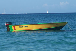 A brightly painted water taxi moored off of Lower Bay Beach.