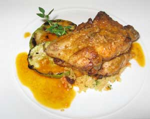 The classic African Chicken - marinated in garlic lemon juice and grilled, served with a coconut and white wine sauce over couscous and grilled zucchini.