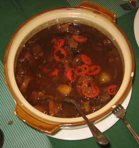Tamarind Pork with red peppers in a rich broth - almost gravy.