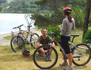 Bicyclists take a break along the trail around Lagoa das Furnas on the island of Sao Miguel.