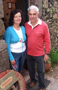 Teatonia and Carlos in the doorway of one of their restored stone houses in Aldeia da Cuada on Flores.