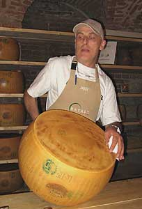 Testing the cheese for doneness at Eataly