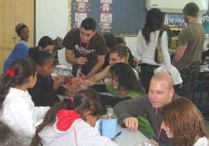 The author, below right, meets with Israeli schoolchildren.