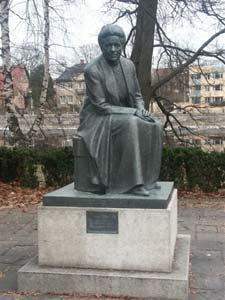 The statue of Selmar Lagerlöf overlooks the Klarälven river opposite the Stadshotell.