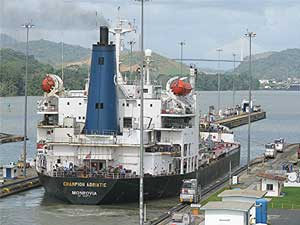 A ship leave Miraflores on the Panama Canal.
