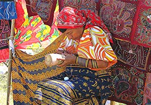 Selling crafted molas in Panama