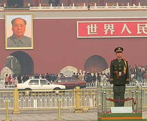 Chairman Mao keeps watch over Tiananmen Square.