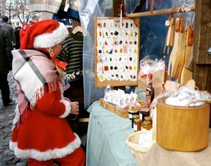 One of Santa's helpers enjoys the Christmas Market shops in Turku.