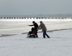 A young family challenging frosty weather on Sopot beach