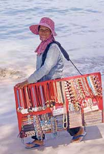Selling necklaces on the beach