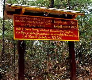 A sign admonishes pilgrims to 'Walk to Gugu's Glory'.