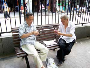Two men playing cards in the park