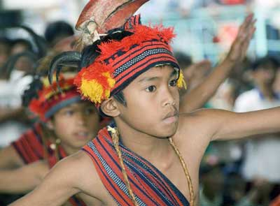 A young dancer with a hornbill headdress