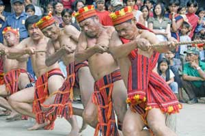 Ifugao men compete in the tug of war at the Imbayah Festival in Banaue, Philippines. Photos by Mike Smith, Asia Photo Stock