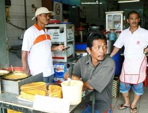 Vendors in a Kuching market