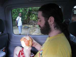 Ian enjoys coconut water straight out of a coconut from one of many fruit vendors along any main Jamaican road.
