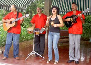 a band welcomes visitors to the Moha Hotel in Las Terrazas.