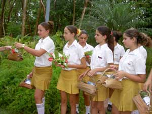 Schoolgirls welcome visitors at the Moha Hotel in Las Terrazas.