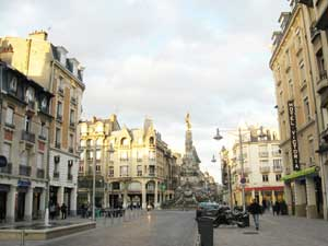 The main thoroughfare in Reims looking past the Best Western Hôtel to the central fountain