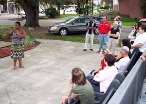 Kathe Hambrick talks to visitors outside theRiver Road African American Museum.