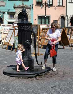 A little girl and her mother in the Old Town