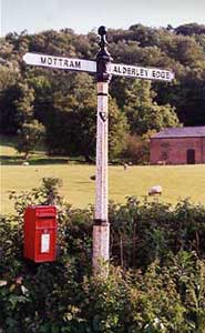 A signpost directs to the town Alderley Edge