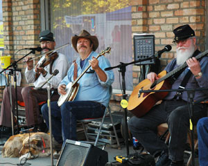 Musicians entertain passersby during the annual  Downtown Farmers' Market in Grand Junction. Photos by  Brian Locklaer