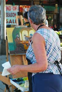 Veggies and fruit aren't the only ones making an appearance at the annual Farmers' Market. Local and regional artists make their way to the city during the festival as well. Visitors can watch them at work and buy their original prints on site.