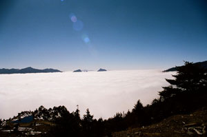 A sea of clouds enveloping everything, as mountain peaks jut out