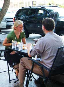A couple enjoying dinner outside in downtown SLC