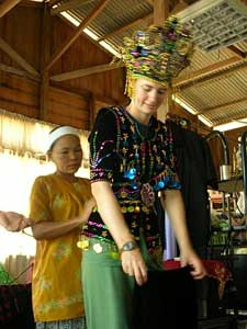 Getting fitted with a Bajau costume