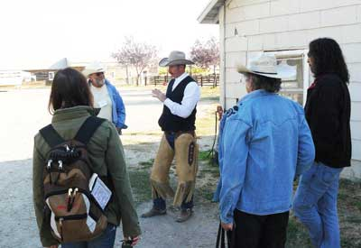 Greg Titus talks to reporters about ranching.