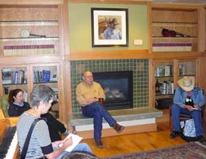 Executive Director Charlie Seeman talks to reporters at the Western Folklife Center