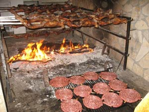 Piglets and sausages on the Sardegnian grill.